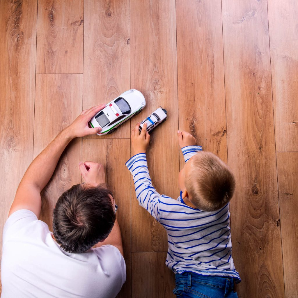 Father with kid playing with toycar | Wacky's Flooring