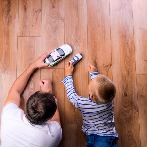 Father with kid playing with toycar   Wacky's Flooring