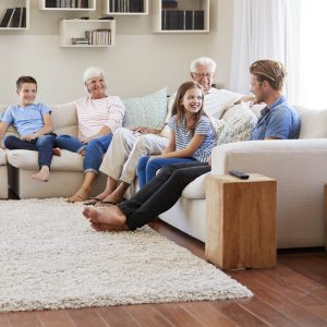 Family spending time together in living room   Wacky's Flooring